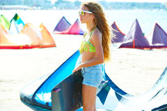 Blond kite surf teen girl in summer beach Royalty Free Stock Image