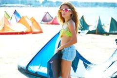 Blond kite surf teen girl in summer beach Stock Images