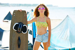 Blond kite surf teen girl in summer beach Stock Photos