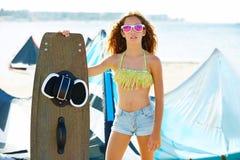 Blond kite surf teen girl in summer beach Stock Photos