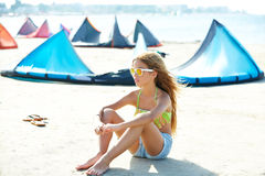 Blond kite surf teen girl in summer beach sitting Royalty Free Stock Photos