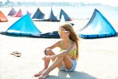 Blond kite surf teen girl in summer beach sitting. On sand Royalty Free Stock Photos