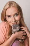 Blond and kitten stock photography