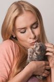 Blond and kitten closeup Stock Images