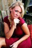 blond klänningredkvinna Fotografering för Bildbyråer