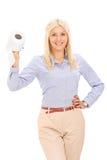 Blond kobieta trzyma papier toaletowy rolkę Obrazy Royalty Free