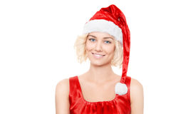 Blond kvinna för härlig yound med den santa hatten Arkivfoto