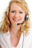 Blond kvinna för affär med hörlurar med mikrofon Arkivbilder