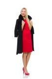 Blond kvinna i den scharlakansröda klänningen som isoleras på viten Royaltyfri Fotografi