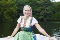 Blond kvinna i Dirndl Royaltyfri Foto