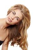 Blond kvinna med långt hår Fotografering för Bildbyråer