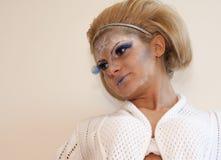 Blond kvinna med smink arkivfoto