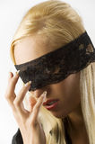 The blond with lace on eyes Stock Image