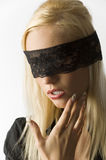 The blond with lace on eyes Stock Photography