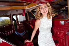 Blond lady arriving in style Royalty Free Stock Photo