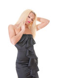 blond lady in black dress against white Stock Photography