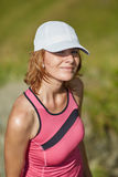 Blond lady with cap Royalty Free Stock Photography