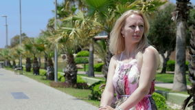 Blond lady enjoys sea breeze. stock video footage