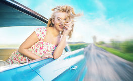 Blond lady during the fast ride Royalty Free Stock Photo