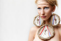 Blond lady with handmade bijouterie Royalty Free Stock Images