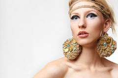 Blond lady with handmade bijouterie Stock Images