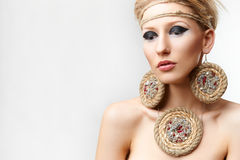 Blond lady with handmade bijouterie Stock Image