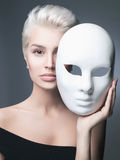 Blond lady with mask. Fashion portrait of blond lady with mask. beautiful girl at the carnival Royalty Free Stock Image