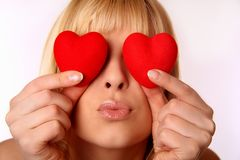 Blond lady with red hearts Royalty Free Stock Photography