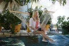 Blond lady resting on a hammock royalty free stock photography