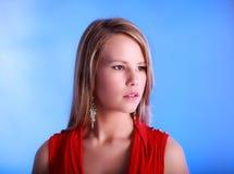 Blond lady soft blue background Royalty Free Stock Image