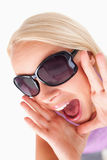 Blond lady with sunglasses in high spirits Royalty Free Stock Image