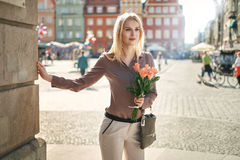 Blond lady waiting for her date Stock Photos