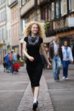 Blond lady walking along street Royalty Free Stock Images