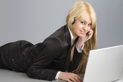 The blond and the laptop Stock Image