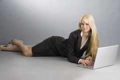The blond and the laptop Royalty Free Stock Photo
