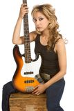 Blond Latina woman guitarist sitting on box Royalty Free Stock Images