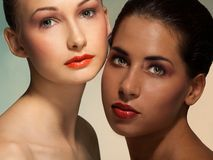 Blond and Latino brunette women portrait Royalty Free Stock Image