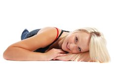 Blond laying down. A cute blond laying down, smiling Stock Photos