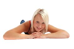 Blond Laying Down. Blond girl laying down on white Stock Image