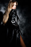 Blond in leather Royalty Free Stock Images
