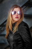 Blond with leather jacket Stock Images