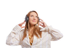 Blond listening to music isolated Royalty Free Stock Photography