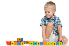Blond little boy with blocks on the floor Royalty Free Stock Photo