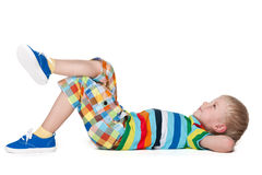 Blond little boy resting Stock Photos
