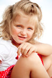 Blond little girl. Little blonde girl  looking to the camera with curiosity Stock Photography