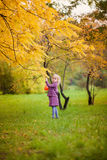 Blond little girl on beautiful autumn day Royalty Free Stock Image