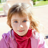 Blond little girl blue eyes portrait in pink Stock Photo