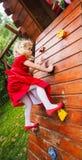 Blond little girl on a climbing wall