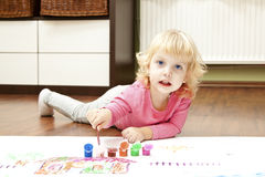 Blond little girl painting Royalty Free Stock Photo