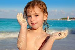 Blond little girl playing beach with sand Stock Photography